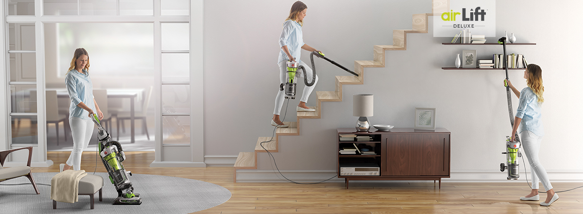Woman vacuuming floor, stairs and shelf. AirLift Deluxe steerable upright with detachable lift canister