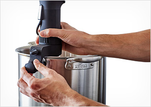Person attaching precision cooker to pot