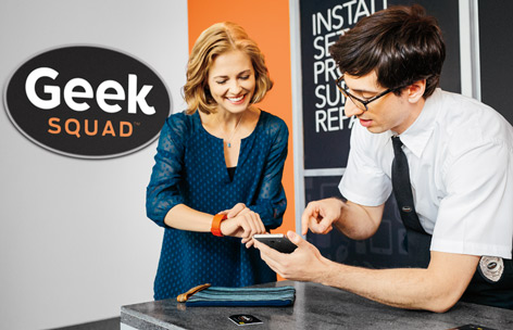Geek Squad agent helping customer with smartwatch