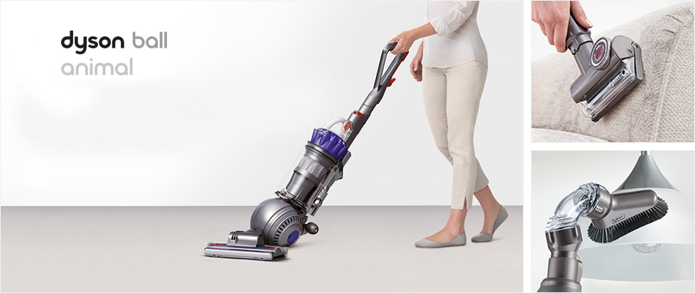 Woman with upright vacuum, Dyson ball animal