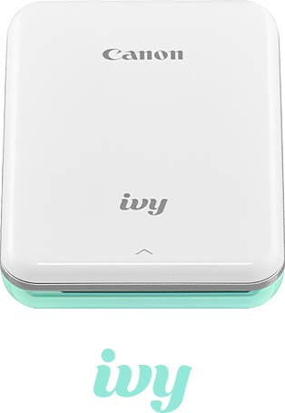 White mini photo printer with mint green accents