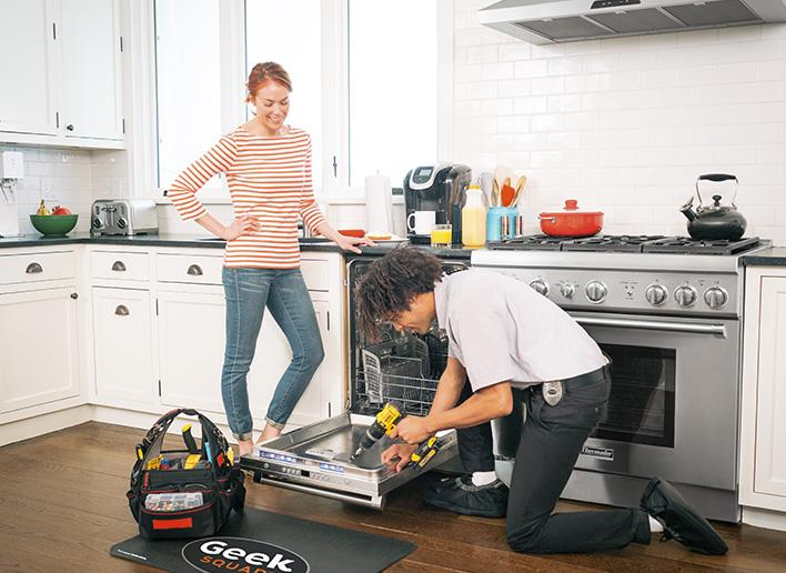 Geek Squad Agent repairing dishwasher, client